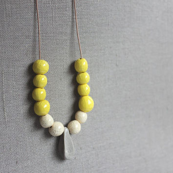 Handmade ceramic beads - strand necklace - yellow, cream and gray - beadwork on thin leather cord