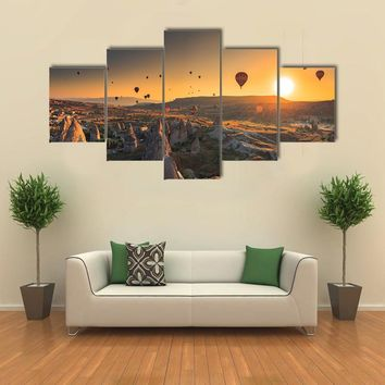 Hot Air Balloon Flying At Sunset In Cappadocia Multi Panel Canvas Wall Art