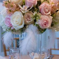 pink flower centerpiece with blue feather - Google Search