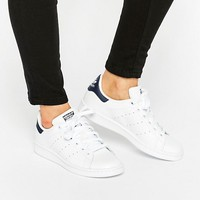 adidas Originals Unisex White And Navy Stan Smith Sneakers at asos.com