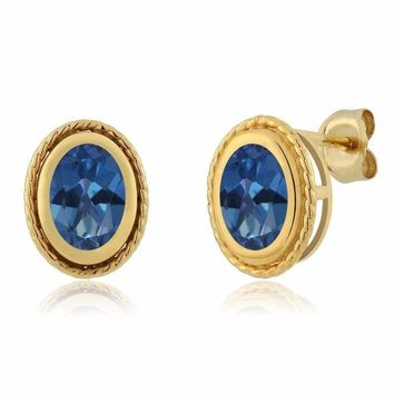 1.90 Ct Oval Shape Royal Blue Mystic Topaz Gold Plated Silver Stud Earrings