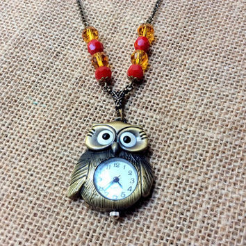 Wizard's Owl Watch Necklace: owl watch with red and yellow crystal beads