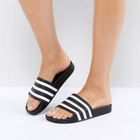adidas Adilette Slider Sandals In Black at asos.com