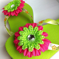 Cute neon green childrens blinged flip flops with hot pink flowers, size Large,thongs,slippers,beach wear,spa shoes