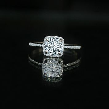 1.5 CT Radiant round center halo ring adorned by Diamond Veneer simulant with line of pave Zirconite electroplated Sterling Silver. 635R202