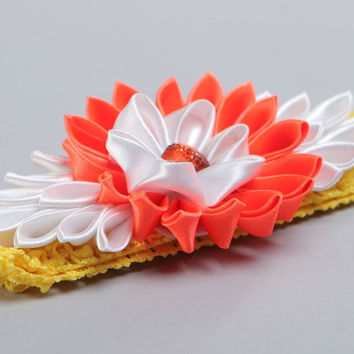 Handmade designer headband with yellow stretch basis and bright kanzashi flower