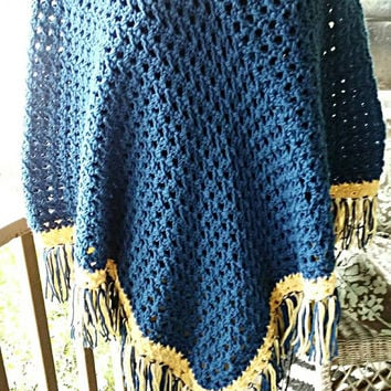Hand Crocheted Poncho in Blue with muted yellow trim and matching fringe. One size fits most.