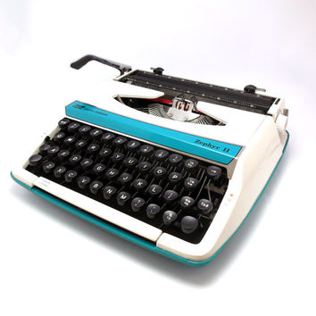 Green 1960s Smith-Corona Zephyr 11 Portable Typewriter. Fully Operational. Includes Portable Carry Case.