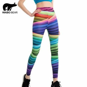 Women's Candy Colors Striped Print Leggings.   One Size (Sizes Small & Medium).     Also Available in Yellow and Black, Black and White and Black/White Design.    ***FREE SHIPPING***