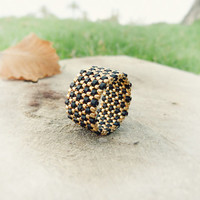 Unisex Black gold textured band ring. Modern seed bead jewelry