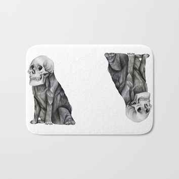 skullpug // A brutal pug wearing a human skull made in pencil Bath Mat by Camila Quintana S