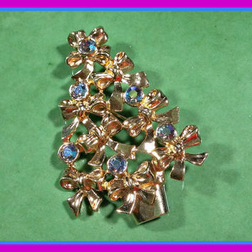 Vintage Christmas Tree Pin Christmas Vintage Avon Gold Metal with Irridescent Blue Purple Faceted Rhinestones Tree Made of Gold Bows Metal