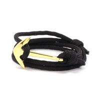 Gold Anchor on Black Rope