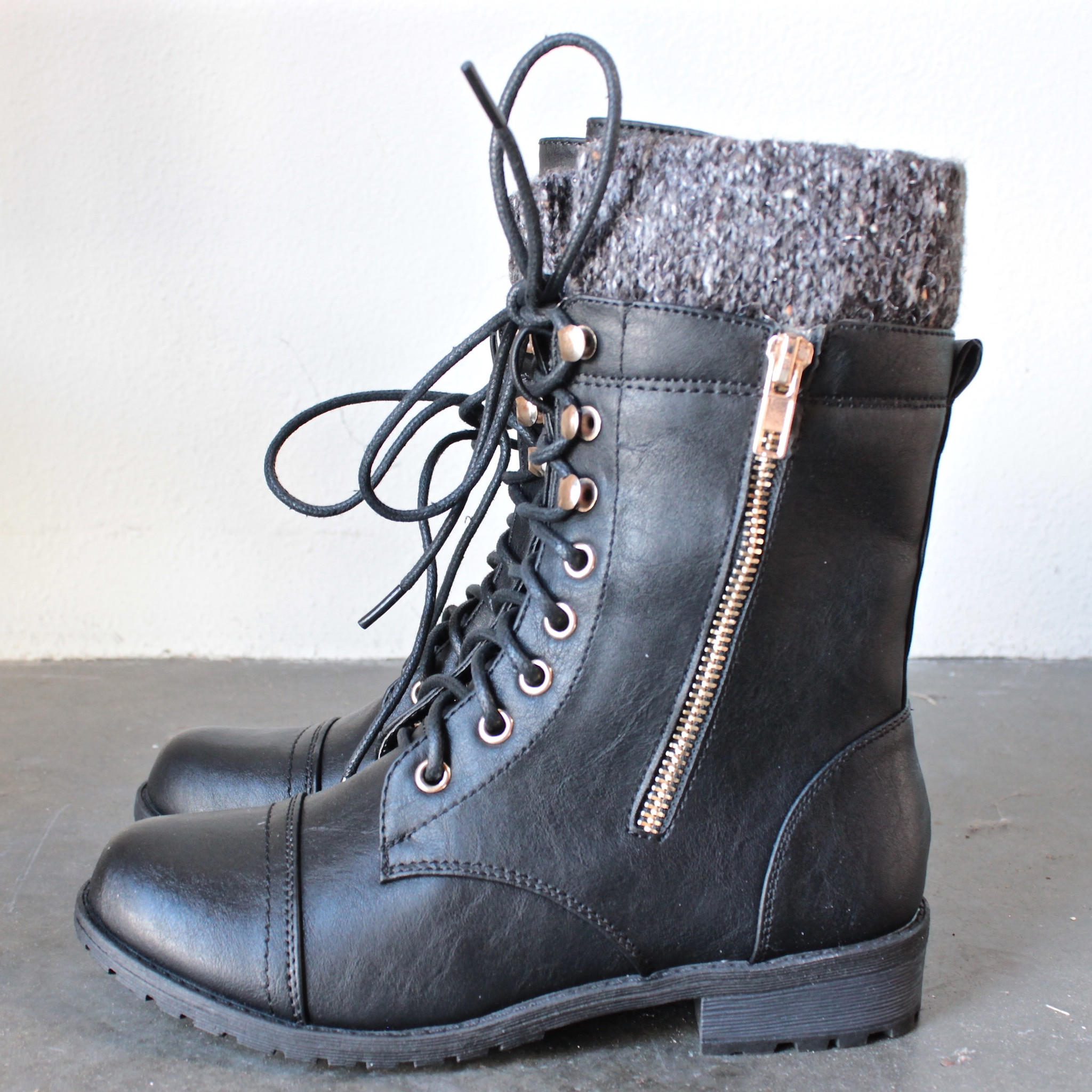 the black laced up combat sweater boots from shophearts | LOW CUT