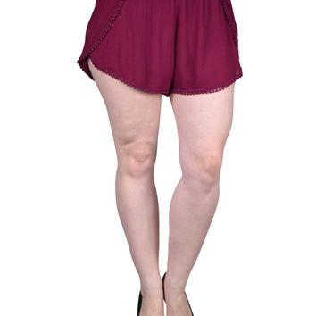 Plus size woven dolphin shorts featuring crochet trim and an elasticized waistband