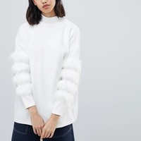 Amy Lynn high neck sweater with fur sleeve trim detail at asos.com