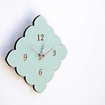 tiny scallop clock in vintage blue by uncommon on Etsy