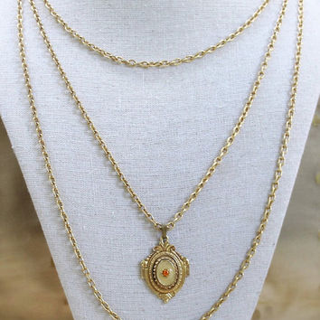 Florenza Multi Strand Chain Necklace With Enamel And Orange Rhinestone Pendant In Gold Tone