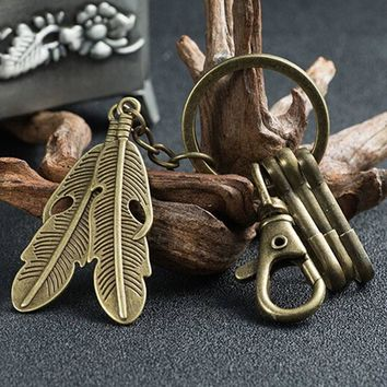 New Design Creative Key Chain Alloy Cute Trojan Feather Key Retro Keychain For Men Women Small Gift