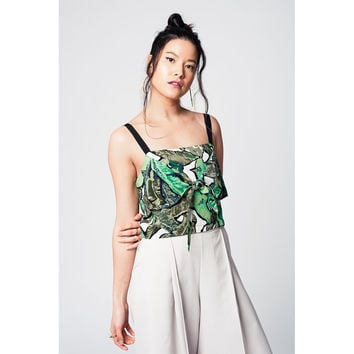 Green crop top with leaves print and black straps