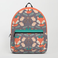 Foxes and rabbits Backpacks by Maria Jose Da Luz