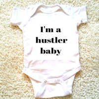 I'm a hustler baby graphic baby clothing for newborn, 6 months, 12 months, and 18 months funny graphic kids shirt