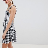 ASOS DESIGN gingham pinafore mini sundress at asos.com