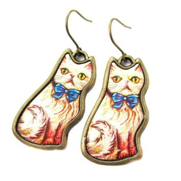 Illustrated Fancy Kitty Cat Animal Dangle Earrings in White with Blue Bow | DOTOLY