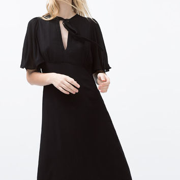 Cape sleeve tie-neck dress