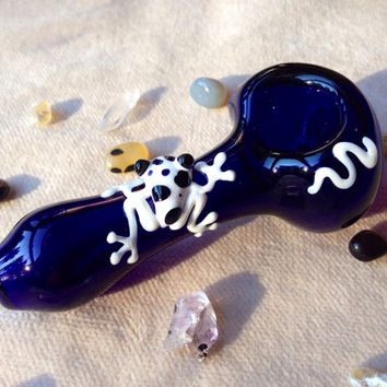 White and Black Spotted Frog Critter on Cobalt Blue Glass Pipe