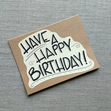 Hand lettered 'Have a Happy Birthday' greeting card, tan and yellow birthday celebration card, blank kraft greeting card.