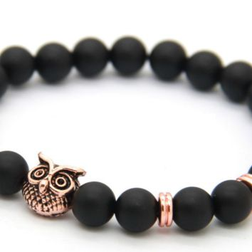 Rose Gold Owl Bracelet on Black Rocks