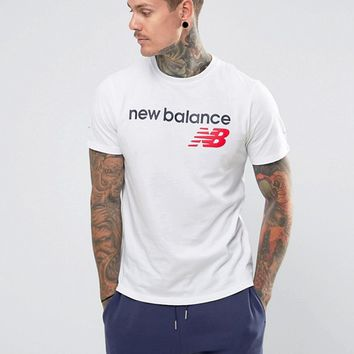 New Balance Athletics Logo T-Shirt In White MT73581_WT at asos.com