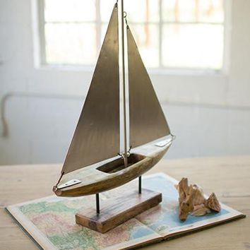 Wood And Iron Sailboat On A Stand