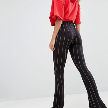 Missguided Tall Pinstripe Flared Pants at asos.com