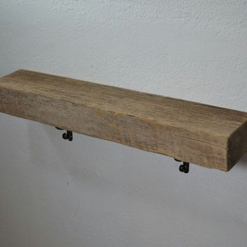 """Thick reclaimed wood wall shelf with metal brackets, 26"""" long and 5"""" deep."""