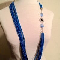 Long blue statement necklace // long blue necklace // front closing necklace // flower charm // multistrand necklace
