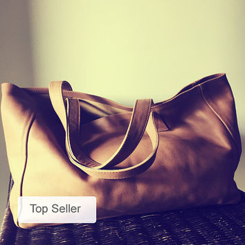 Caramel leather tote made from soft leather.Traditional,genuine leather tote shoulder bag has long strong straps,generous size shopper