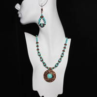 Embossed Copper Pendant with Turquoise Magnesite Cabochon and Turquoise Coral Fossil Riverstone Beads with Copper