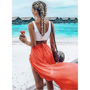 Fashion trend women's beach skirts are wearing sun-protective clothing