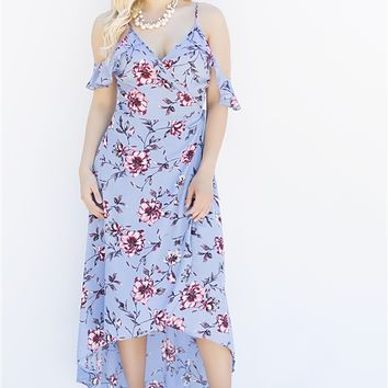 Ready and set to go, all you need is good weather right? No worries, everything will be grand in the Waiting For The Sun dress!Cold shoulder, sleeveless with spaghetti straps, overlay wrap with tie, low v-back, hi-low hem, floral print maxi.