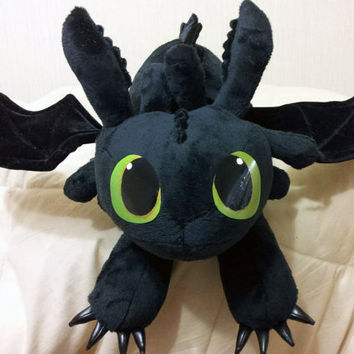 How to Train Your Dragon inspired Toothless the Night Fury (60 cm long) large plushie, made of minky plush with posable wings.