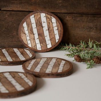 Set of 4 Rustic Wood Slice Coasters with cork backing. Wood burned and painted birch or aspen trees design on spalted oak.