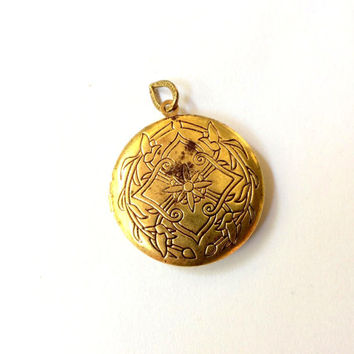 round floral locket with natural brown patina