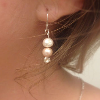 Beautiful dangle pearl earring with silver wire spiral.