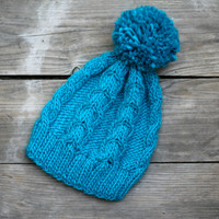 Knit beanie hat in turquoise blue color with cables and pom pom