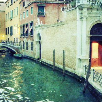 Venice Italy canal with emerald green waters in the early evening - Venice at Dusk