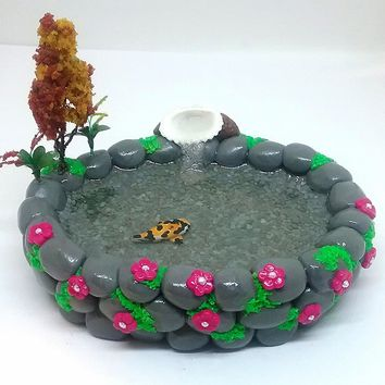 Fairy garden accessories. Miniature koi fish pond with shell fountain.
