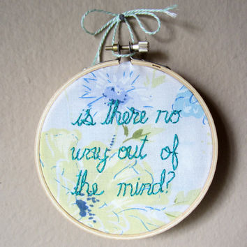 "Sylvia Plath quote, hand embroidery, 4"" hoop. Is there no way out of the mind? Blue, yellow, & green floral on white fabric"