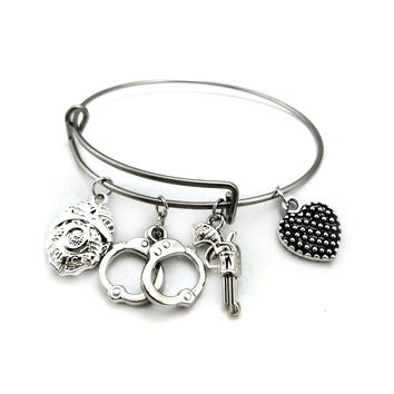 Bracelet With Badge, Handcuffs & Gun Charms